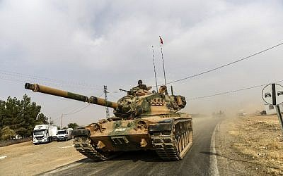 A picture taken around 5 kilometers west from the Syrian-Turkish border city of Karkamis in the southern region of Gaziantep, shows Turkish Army tanks driving to the Syrian border town of Jarabulus, August 25, 2016. (AFP/BULENT KILIC)