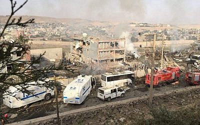 Illustrative photo of Turkish police and firefighters near a damaged police headquarters after a car bomb killed eleven Turkish police officers and injured 45 people on August 26, 2016 in Cizre, southeastern Turkey, an attack blamed on Kurdish militants, state media said. (AFP/Dogan News Agency/STR)
