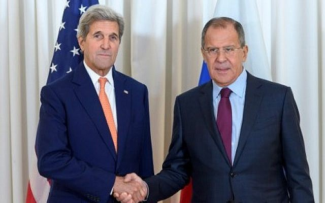 File: US Secretary of State John Kerry, left, shakes hands with Russian Foreign Minister Sergey Lavrov, on August 26, 2016, as they meet in Geneva for an expected push towards resuming peace talks for war-ravaged Syria. (AFP Photo/Pool/Martial Trezzini)