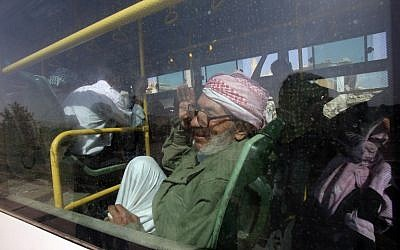 An elderly man is seen gesturing inside a bus, as they are being evacuated from the town of Daraya outside the capital Damascus on August 26, 2016, under a deal agreed between the government and opposition fighters after a four-year army siege. (AFP PHOTO/Youssef KARWASHAN)