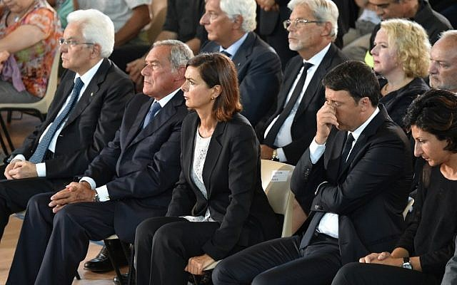 (LtoR) Italian President Sergio Mattarella, Italian Senate President Pietro Grasso, Italian Lower House Speaker Laura Boldrini, Italian Prime Minister Matteo Renzi and his wife Agnese attend a funeral service for victims of the earthquake, at a gymnasium arranged in a chapel of rest on August 27, 2016, in Ascoli Piceno, three days after a 6.2-magnitude earthquake struck the region killing some 290 people. (AFP PHOTO/ALBERTO PIZZOLI)
