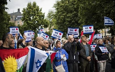 """People hold up pro-Israel banners at a """"'Taking Back Zionism""""' rally at Raoul Wallenberg Square in Stockholm on August 28, 2016. (AFP PHOTO/JONATHAN NACKSTRAND)"""