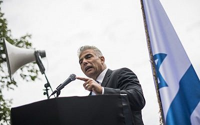 """Yesh Atid leader MK Yair Lapid addresses the crowd during a """"'Taking Back Zionism""""' rally for Israel at Raoul Wallenberg Square in Stockholm on August 28, 2016. (AFP/Jonathan Nackstrand)"""
