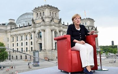 German Chancellor Angela Merkel gestures during her summer interview with journalists of German public broadcaster ARD on August 28, 2016 in Berlin. (AFP/dpa /Rainer Jensen)
