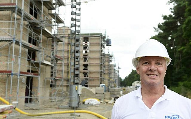 Werner Jung, sales representative of Irisgerd real estate agency posing at the construction site for luxury apartments at the heritage-protected Prora Complex in Prora, near Binz, on the island of Ruegen, August 18, 2016. (AFP PHOTO / TOBIAS SCHWARZ).