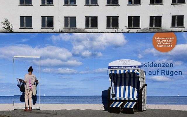 An advertising banner in front of the heritage-protected Prora Complex that is being turned into luxury apartments in Prora, near Binz, north-eastern Germany, August 17, 2016 . (AFP PHOTO / TOBIAS SCHWARZ).
