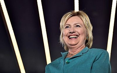 Democratic presidential nominee and former Secretary of State Hillary Clinton smiles before she speaks at the International Brotherhood of Electrical Workers Union Hall on August 4, 2016 in Las Vegas, Nevada. (David Becker/Getty Images/AFP)