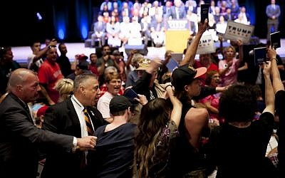 Protesters holding up copies of the Constitution are escorted out of Republican presidential candidate Donald Trump's speech at the Merrill Auditorium in Portland, Maine, on August 4, 2016. (Sarah Rice/Getty Images/AFP)