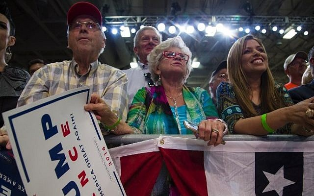 Supporters listen to Republican presidential candidate Donald Trump speak at a rally on August 5, 2016 in Green Bay, Wisconsin. (Darren Hauck/Getty Images/AFP)