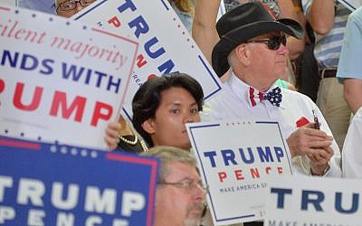 A supporter of Republican presidential candidate Donald Trump awaits his arrival for a campaign event at Trask Coliseum on August 9, 2016 in Wilmington, North Carolina. (Sara D. Davis/Getty Images/AFP)