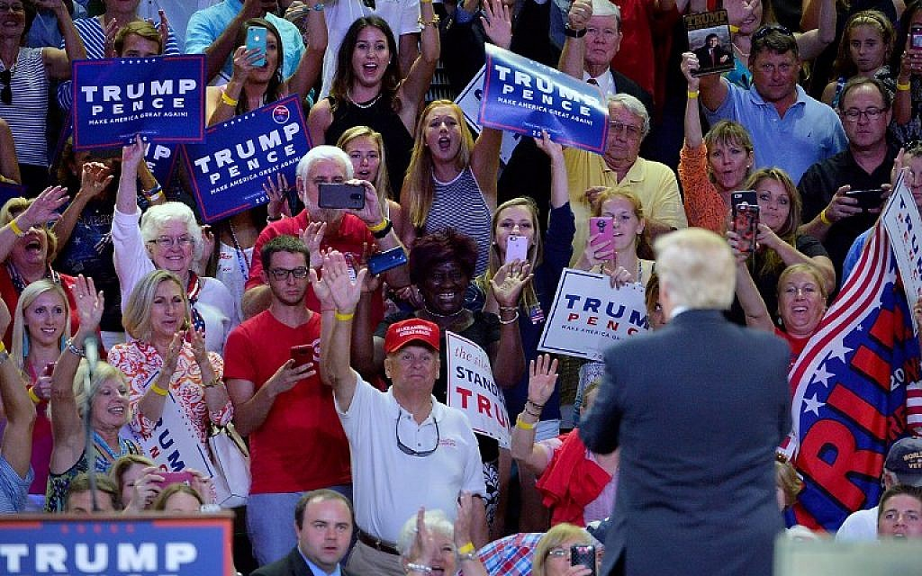 Supporters for Republican presidential candidate Donald Trump cheer for him during a campaign event at Trask Coliseum on August 9, 2016 in Wilmington, North Carolina. (Sara D. Davis/Getty Images/AFP)