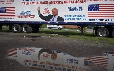 A Donald Trump decorated 18 wheeled truck is reflected before Democratic Presidential candidate Hillary Clinton holds a rally with Vice President Joe Biden at Riverfront Sports athletic facility on August 15, 2016 in Scranton, Pennsylvania. Mark Makela/Getty Images/AFP)