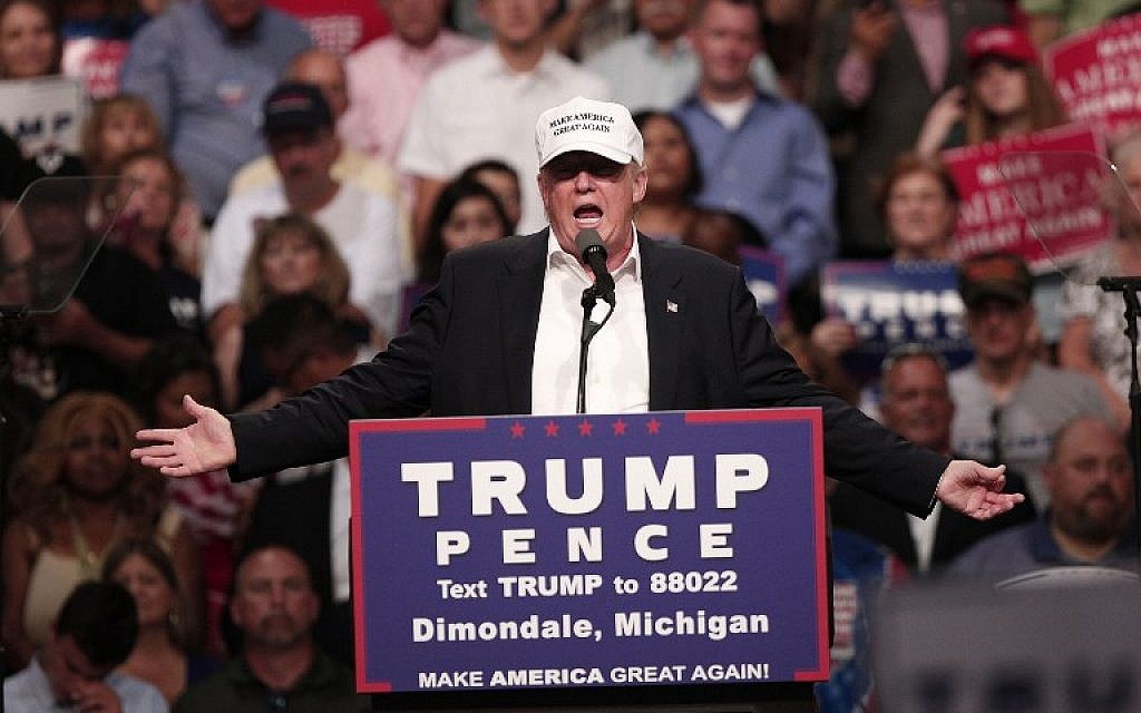 Republican presidential nominee Donald Trump speaks at a campaign rally in Dimondale, Michigan on August 19, 2016. (Bill Pugliano/Getty Images/AFP)