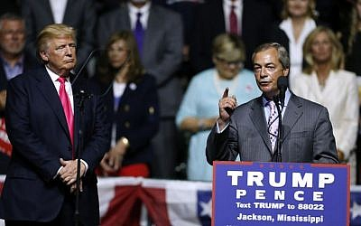 Republican Presidential nominee Donald Trump, left, listens to United Kingdom Independence Party leader Nigel Farage speak during a campaign rally at the Mississippi Coliseum, Jackson, Mississippi, August 24, 2016. (Jonathan Bachman/Getty Images/AFP)