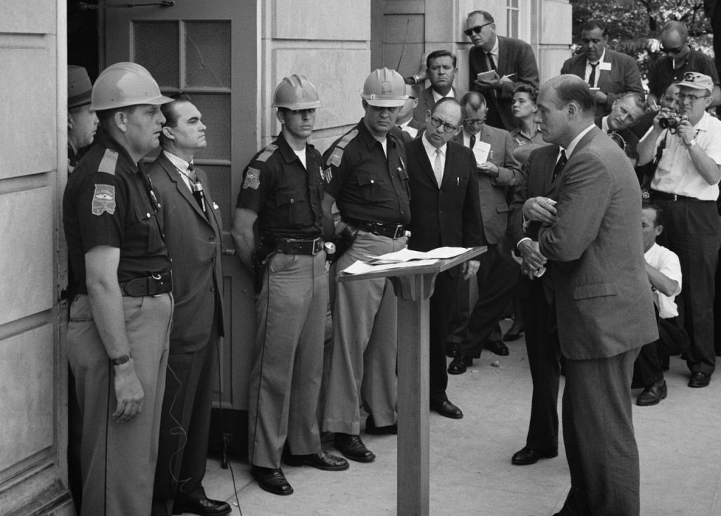 Wallace standing against desegregation while being confronted by Deputy U.S. Attorney General Nicholas Katzenbach at the University of Alabama in 1963. (Public domain/Wikipedia)