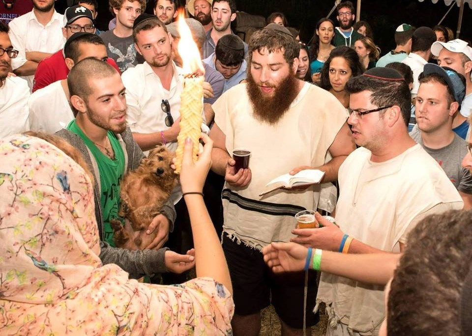 Festivalgoer Refael Tessler (center) leads the Havdallah ceremony after Shabbat at The Camping Trip. (Jake Sojcher)