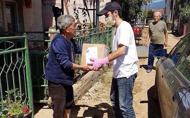 A volunteer delivering hygiene relief kits to Macedonians affected by a devastating flood that hit the region in August 2016. (Courtesy of JDC.JTA)
