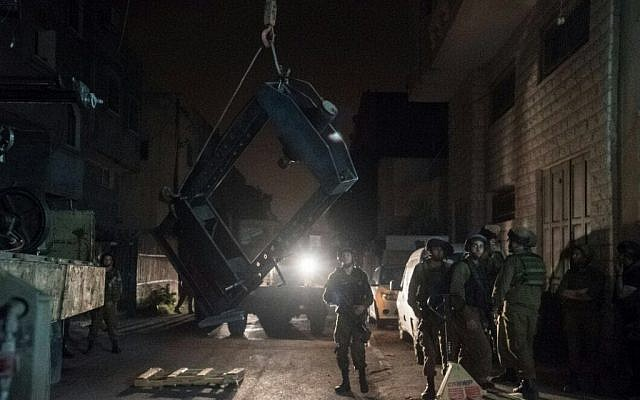IDF troops remove weapon-making machinery from a workshop in the West Bank, in an image released August 1, 2016. (IDF Spokesperson)