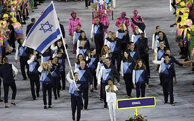 Neta Rivkin carries the flag for the Israeli delegation during the opening ceremony for the 2016 Summer Olympics in Rio de Janeiro, Brazil, Friday, Aug. 5, 2016. (AP Photo/Matt Slocum)