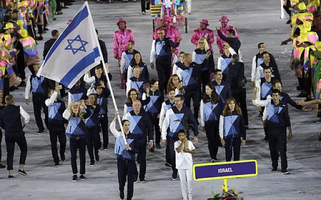 Neta Rivkin carries the flag for the Israeli delegation during the opening ceremony for the 2016 Summer Olympics in Rio de Janeiro, Brazil, Friday, Aug. 5, 2016. (AP Photo/Matt Slocum)