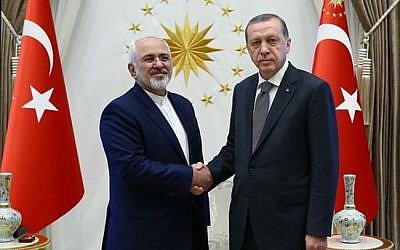 File: Turkish President Recep Tayyip Erdogan, right, shakes hands with Iranian Foreign Minister Mohammad Javad Zarif at a meeting in Ankara, Friday, August 12, 2016. (Kayan Ozer/Presidential Press Service via AP)