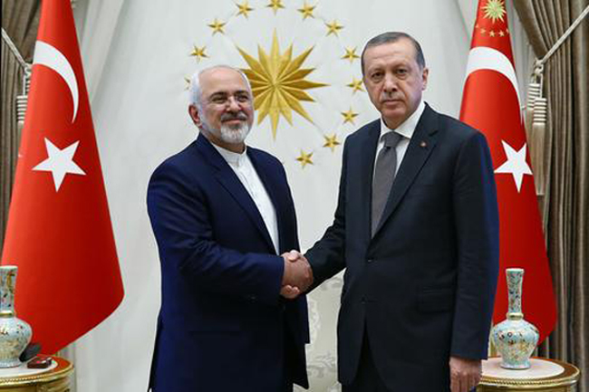 File Turkish President Recep Tayyip Erdogan right shakes hands with Iranian Foreign Minister Mohammad Javad Zarif at a meeting in Ankara Friday
