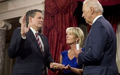 VP Joe Biden administers the Senate oath to Sen. Steve Daines R-Mont., with wife Cindy Daines, during a swearing-in ceremony, Tuesday, Jan. 6, 2015, in the Old Senate Chamber of Capitol Hill in Washington. (Jacquelyn Martin/AP)