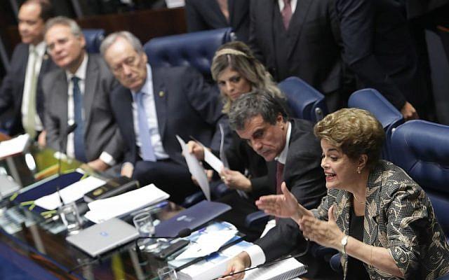 Brazil's suspended President Dilma Rousseff speaks at her own impeachment trial, in Brasilia, Brazil, August 29, 2016. (AP Photo/Eraldo Peres)