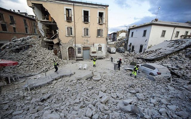 The side of a building is collapsed following an earthquake, in Amatrice Italy, August 24, 2016. (Massimo Percossi/ANSA via AP)