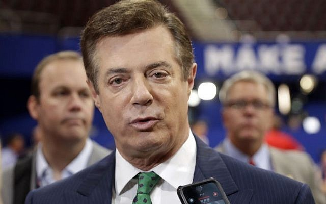 In this July 17, 2016 file photo, then-Trump campaign chairman Paul Manafort talks to reporters on the floor of the Republican National Convention at Quicken Loans Arena in Cleveland. (Matt Rourke/AP)
