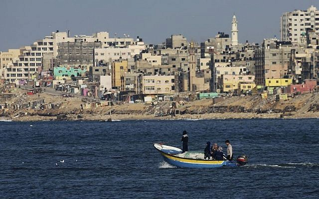 Palestinian fishermen on a boat off the coast of the Gaza Strip, February 9, 2016. (AP Photo/Adel Hana)