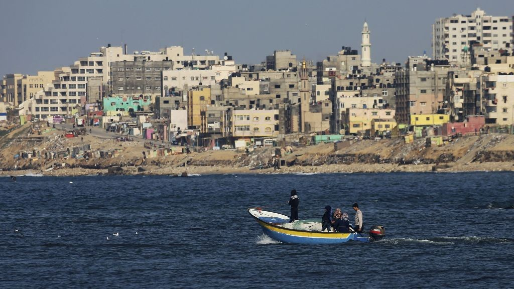 Palestinian fishermen on a boat off the coast of the Gaza Strip