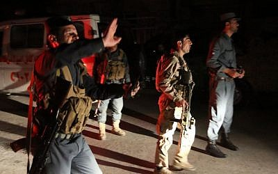 Afghan security forces rush to respond to a complex attack on the campus of the American University in the Afghan capital Kabul on Wednesday, Aug. 24, 2016. (AP/Rahmat Gul)
