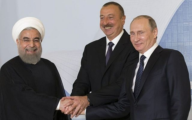 Iranian President Hassan Rouhani, left, Azerbaijan's President Ilham Aliyev, center, and Russian President Vladimir Putin pose for a photo during their meeting in Baku, Azerbaijan, August 8, 2016. (AP/Alexander Zemlianichenko, pool)