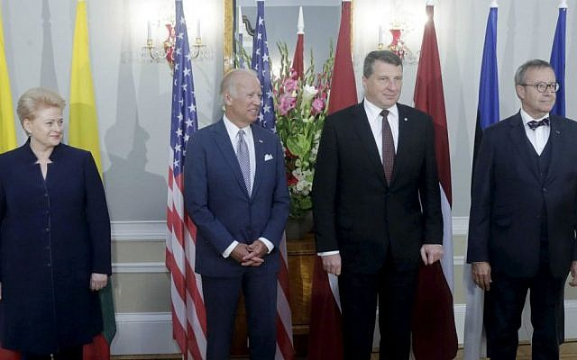 From left: Lithuanian President Dalia Grybauskaite, US Vice President Joe Biden, Latvian President Raimonds Vejonis and Estonian President Toomas Hendrik Ilves pose for a photo during a press conference after their meeting in Riga, Latvia, Tuesday, Aug. 23, 2016. (Latvian Presidential Press Service Photo via AP)