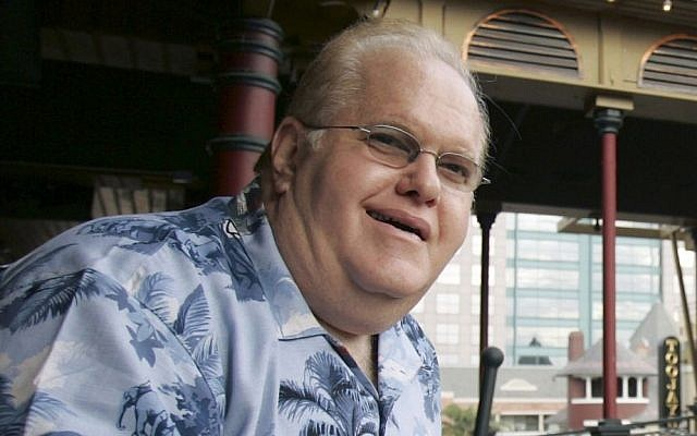 In this June 27, 2007, file photo Lou Pearlman poses outside his office's at Church Street Station in Orlando, Florida. (AP Photo/John Raoux, File)