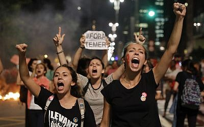 Demonstrators shout slogans against acting Brazil's President Michel Temer during a rally in support of Brazil's suspended President Dilma Rousseff in Sao Paulo, Brazil, August 29, 2016. (AP Photo/Andre Penner)