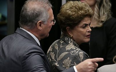 Brazil's Senate leader Renan Calheiros points to an exit as suspended President Dilma Rousseff leaves the Senate chambers after addressing the lawmakers, August 29, 2016. (AP Photo/Eraldo Peres)