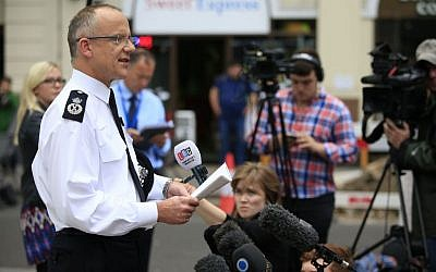 Scotland Yard's Assistant Commissioner Mark Rowley speaks to the media outside New Scotland Yard, in London, August 4, 2016. (Jonathan Brady/PA via AP)
