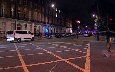 The area where a mass stabbing attack happened in London's Russell Square is cordoned off by police, Thursday, Aug. 4, 2016. (Sky News via AP)