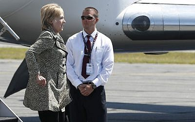 Democratic presidential candidate Hillary Clinton steps from her campaign plane as she arrives at Nantucket Memorial Airport in Nantucket, Massachusetts, Saturday, Aug. 20, 2016 en route to a fundraiser. (AP Photo/Carolyn Kaster)