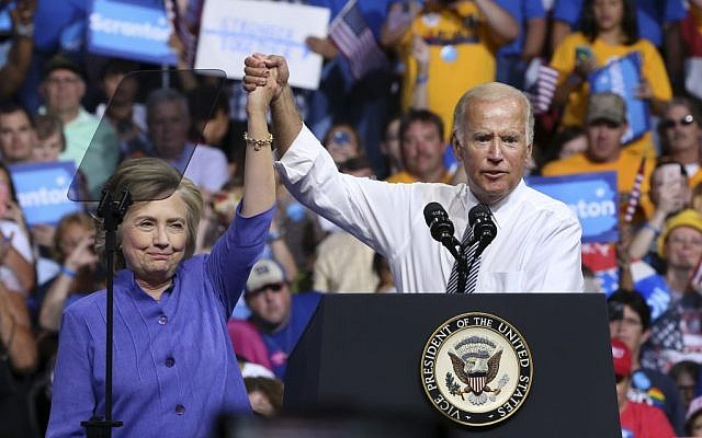 Democratic presidential candidate Hillary Clinton and Vice President Joe Biden hold hands in the air during a campaign rally, Monday, Aug. 15, 2016, in Scranton, Pa. (AP Photo/Mel Evans)
