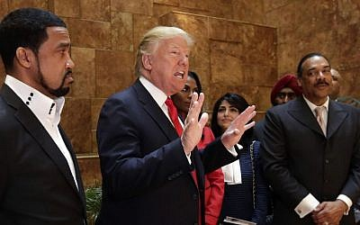 In this April 18, 2016 file photo, Pastor Darrell Scott listens at left as Republican presidential candidate Donald Trump speaks in Trump Tower building in New York. (AP/Richard Drew, File)