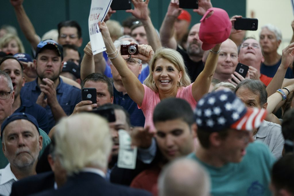 Supporters cheer for Republican US presidential candidate Donald Trump during a campaign rally at Windham High School in Windham, New Hampshire, on August 6, 2016. (Evan Vucci/AP Photo)