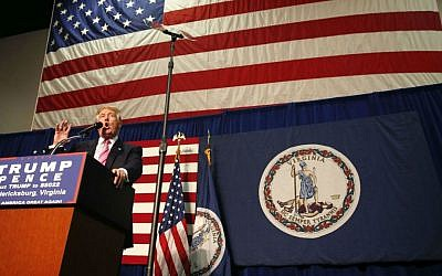Republican presidential candidate Donald Trump arrives to speak at a campaign rally in Fredericksburg, Virginia, Saturday, Aug. 20, 2016. (AP Photo/Gerald Herbert)