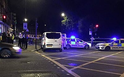 Police at London's Russell Square early Thursday, August 4, 2016 after a stabbing spree left one woman dead and at least six people injured. (Twitter screen capture)