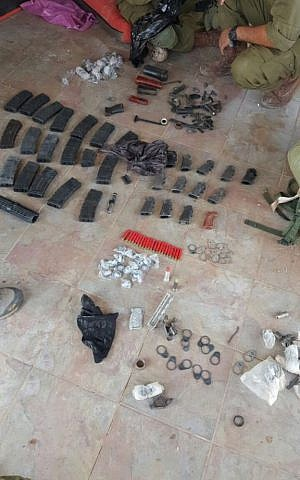 Ammunition, magazines and other military equipment discovered by IDF troops in Khirbat Abu Lahm, northwest of Jerusalem, during a raid on August 10, 2016. (IDF Spokesperson's Unit)