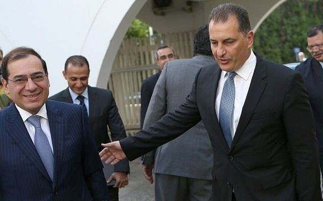 Cyprus' Energy Minister Yiorgos Lakkotrypis, right, welcomes Egypt's Petroleum Minister Tarek el-Molla following their meeting at the Cyprus' Energy ministry in Nicosia, Cyprus, Wednesday, August 31, 2016.  (AP Photo/Petros Karadjias)