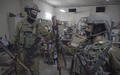 IDF soldiers, along with the police and Shin Bet security service, seize dozens of illegal weapons in Bethlehem and Hebron on August 23, 2016, as part of a large crackdown effort on illicit guns in the West Bank. (IDF Spokesperson's Unit)