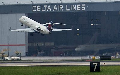 A Delta Air Lines plane takes off at Atlanta's Hartsfield International Airport in Atlanta, August 8, 2016. (AP Photo/Branden Camp)